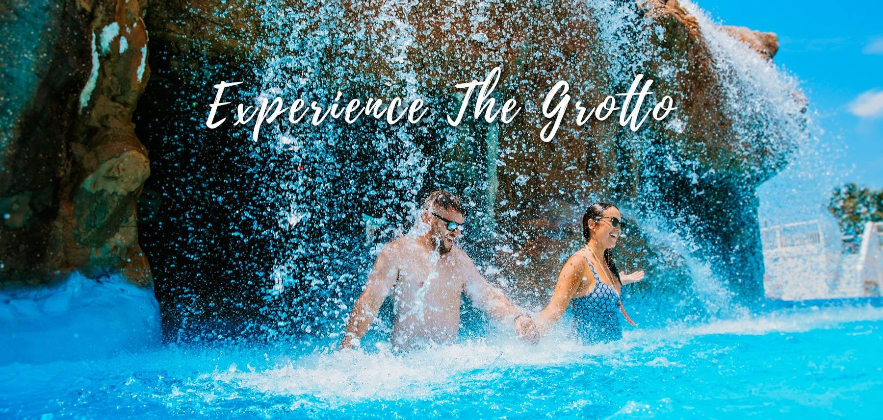 Couple Going under Grotto Waterfall Pool at The Island by Hotel RL